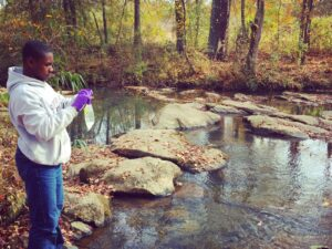 image of student testing water quality